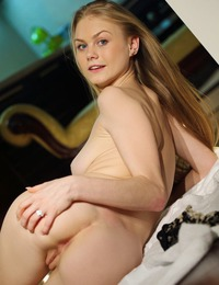"""""""Blue-eyed darling Nancy with smooth creamy complexion and magnificent, round assets."""""""